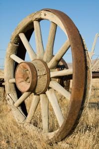 bigstockphoto_old_wagon_wheel_1497286